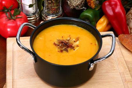 butternut: Small pot of butternut squash soup sprinkled with toasted coconut.