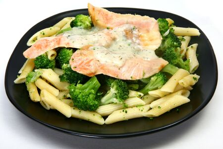 Creamy Dill Salmon.  Salmon fillets over pasta and broccoli with dill sauce.