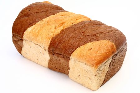 Loaf of marble rye bread over white background.