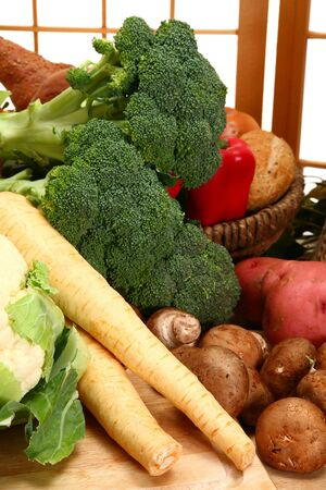 parsnips: Parsnips, mushrooms, potatoes, broccoli, cauliflower, peppers, in kitchen. Stock Photo