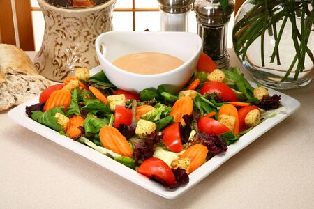 Creamy garlic french dressing and salad in kitchen or restaurant. Standard-Bild