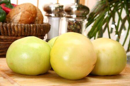 Green tomatoes in kitchen or restaurant.