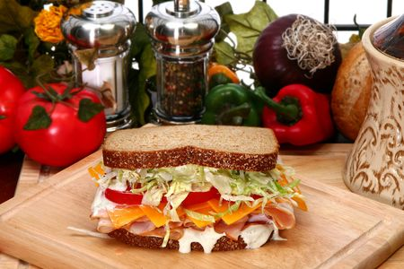 multi grain sandwich: Fresh turkey sandwich with honey rosted deli turkey, shredded lettuce, cheddar cheese, tomatoes and ranch dressing on whole wheat.