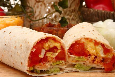 restuarant: Egg burrito sliced open in restuarant or kitchen.