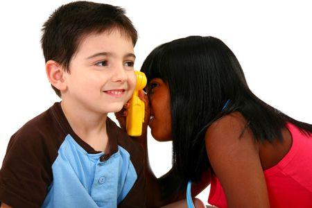 Two adorable kids pretending medical exam.