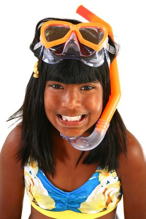 Adorable 10 year old Indian girl with snorkel and mask.