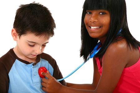Adorable kids playing doctor and patient. photo