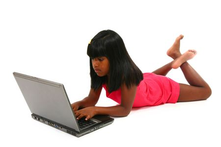 Beautiful 10 year old girl with laptop over white.