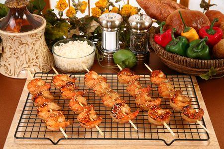 Ginger Teriyaki Shrimp Kebabs in kitchen or restaurant. photo