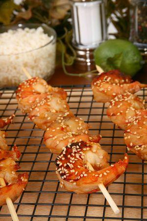 Ginger Teriyaki Shrimp Kebabs in kitchen or restaurant. Stock Photo