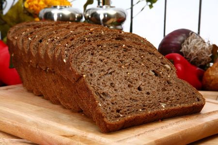 protien: Loaf of dark wheat bread in kitchen.