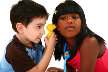 Two adorable children playing doctor and patient. photo