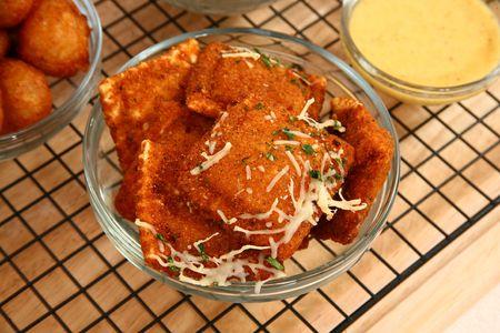 Fried ravioli in kitchen or restaurant with sauces. Reklamní fotografie