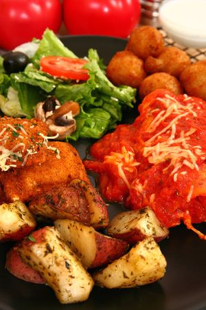 Stuffed mushrooms, fried ravioli, oven baked potatoes, marinara, honey mustard, ranch dressing, Cheese Manicotti, salad. Stock Photo - 3560286