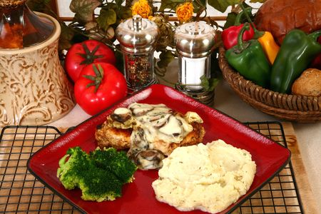 brocolli: Grilled chicken covered in cheese sauce, portobello mushrooms and onions.