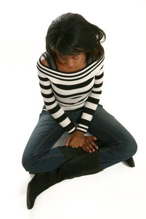 Sad woman full body sitting. Stock Photo - 3571475