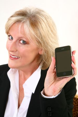 Attractive 40 something woman holding cellphone.