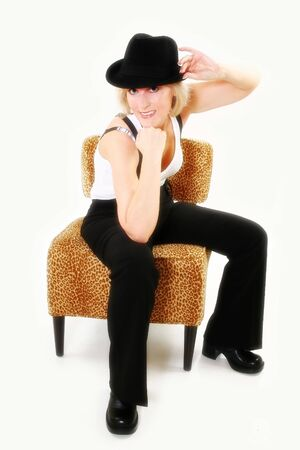 Sexy forty year old woman in suspenders and black hat. Stock Photo - 3583827