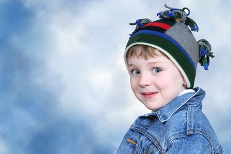 Four year old boy in crazy looking winter cap and a denim jacket.  Shot with the Canon 20D. Standard-Bild
