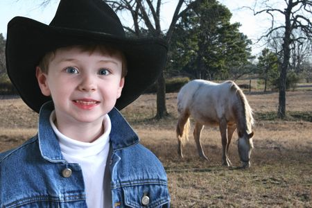 four year old: Adorable four year old  in denim jacket and black cowboy hat.  Shot with the Canon 20D.