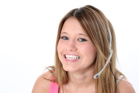 Beautiful teen girl with headset and big smile over white. Great for teen hotline or just gossiping with friends. photo