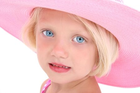 huge: Beautiful young girl with blonde hair and bright blue eyes in a pink hat.  Shot in studio over white with the Canon 20D.