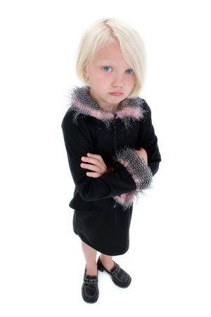 Beautiful Little Pouting Girl In Black Suit With Pink Feathers standing with arms crossed.  Shot in studio.
