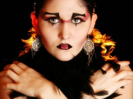 mardigras: Beautiful seventeen year old girl in artistic make-up. Stock Photo