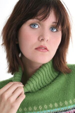 Close Up of Beautiful Teen Girl In Green Sweater.  Dark hair and blue eyes. Shot in studio over white. Stock Photo - 3741247