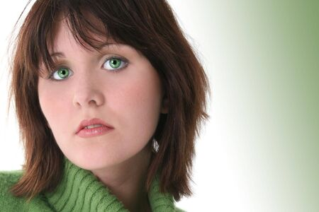 Close Up of Beautiful Teen Girl In Green Sweater.  Dark hair and green eyes. Shot in studio over white. Stock Photo - 3741064