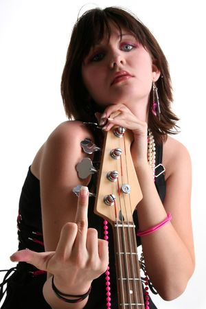 finger teen:  Beautiful Sixteen year old girl sitting with bass, shooting the finger towards camera.