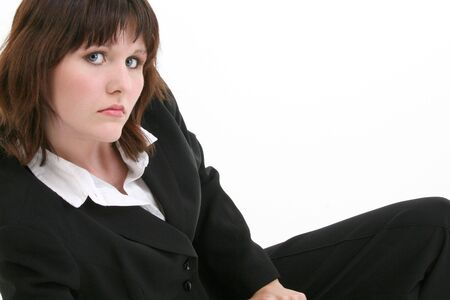 brown hair blue eyes: Smart and Beautiful young business woman.  Shot in studio over white.  Brown hair, blue eyes, black business suit. Stock Photo