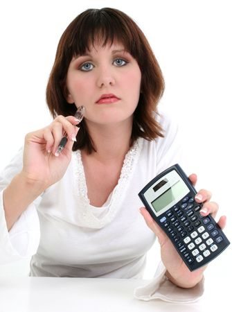 job loss: Beautiful Young Woman with Ink Pen and Calculator. Shot over white. Stock Photo