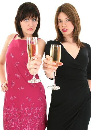 Upper body shot of two girls making a toast at a party Stok Fotoğraf