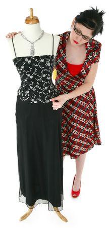 formal dressing: Sales woman dressing mannequin in formal dress. Full body over white.   Stock Photo