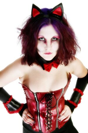 18 year old: High key potrait of beautiful 18 year old girl in goth make-up and purple tinted hair.