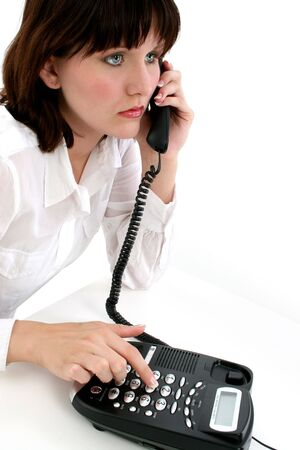 Teen girl talking on telephone. photo