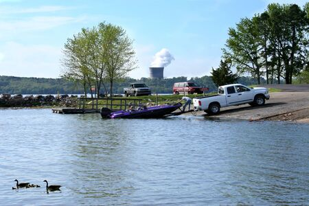 power boat: Boater pulling his boat from the arkansas river.