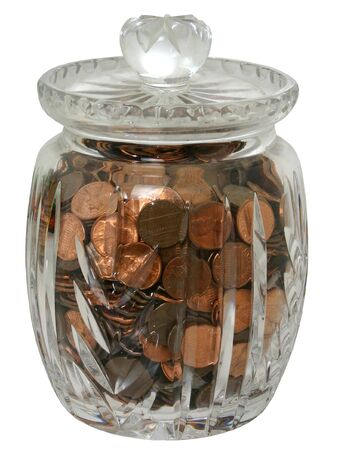 pennies: Decorative crystal jar of pennies isolated on white.
