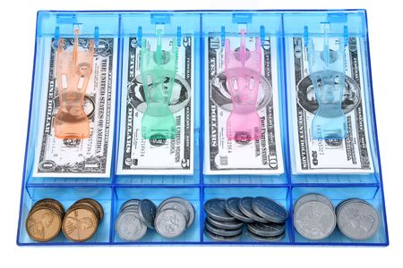cabinets: Blue plastic cash drawer full of toy money.