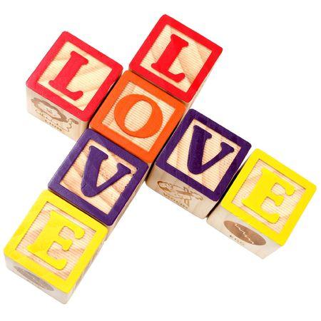Liefde gespeld met alphabe-blokken in kris-kras-stijl Stockfoto