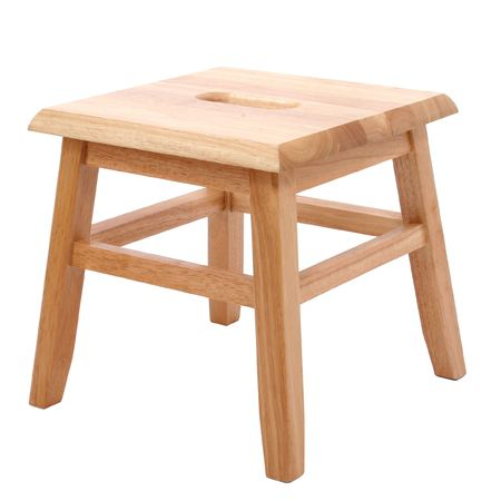 stool: Small four legged wooden step stool over white Stock Photo