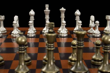Wooden chess board with metal peices.  Shot in studio on black.  Nice detail on light pieces.  Stock Photo - 3745747
