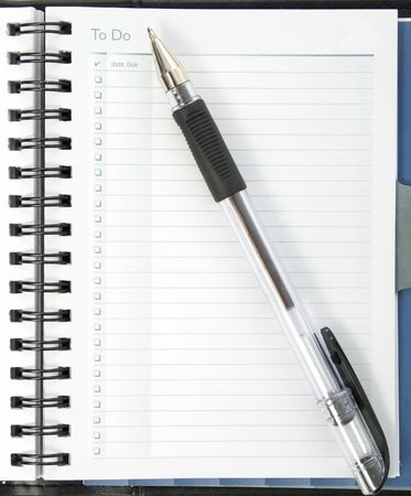 Open planner book with empty To Do page and ink pen.