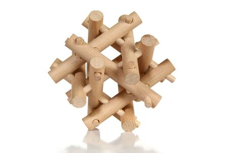 Wooden puzzle over white background. Imagens - 3745708