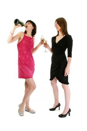 drunk woman: Two girls drinking champagne at a party.  Stock Photo