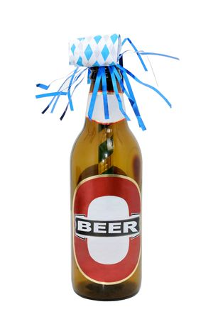 Empty beer bottle with a party favor (noise maker) stuck inside.  Isolated on white
