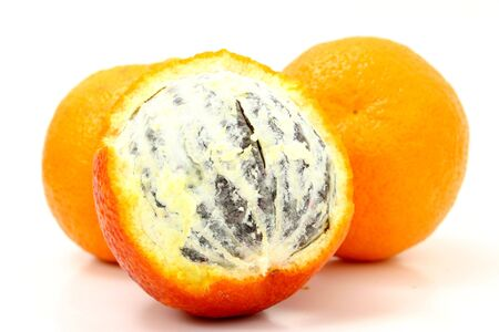 flaky: Close up of a Blood Orange.  Color and odd flaky texture are this fruits natural appearance. Stock Photo
