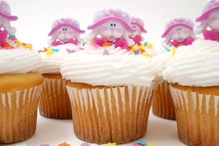 Close-up of row of Easter bunny cupcakes.   photo
