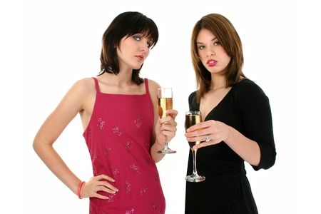 Upper body shot of two girls drinking champagne at a party. Shot with a Canon 20D.